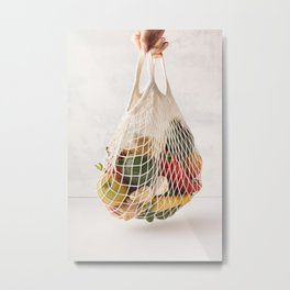 Woman's hand holding a cotton bag of mixed fruit and vegetables Metal Print