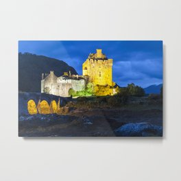 Eilean Donan Castle on a cloudy night lit with coloured lights Metal Print