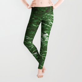 Texture of crumpled foil from green waves on dark water. Leggings