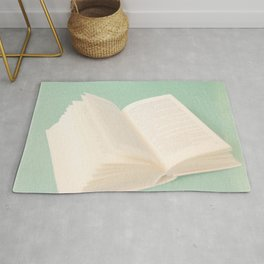 Open Book on Blue Textured Background (Vintage and Retro Still Life Photography)  Rug