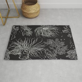 Seaweed and corals on black Rug