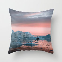 Boat in front of arctic icebergs during sunset Throw Pillow