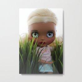 Doll among the grass Metal Print