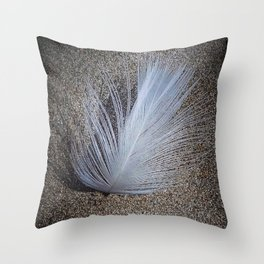 white feather and beach sand Throw Pillow
