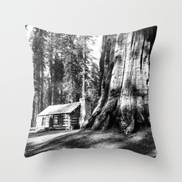 A log cabin dwarfed by a Big Tree in Mariposa Grove in Yosemite National Park, ca.1920 Throw Pillow