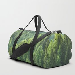 Pine tree forest in the morning fog Duffle Bag