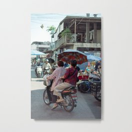 Old ladies riding a scooter a t the local market Metal Print