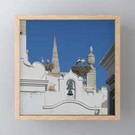 storks build nests on the church in the old town of faro, portugal, europe Framed Mini Art Print