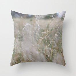 Tall wild grass growing in a meadow Throw Pillow