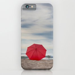 Red umbrella lying at the beach iPhone Case