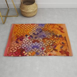 a piece of orange pink and purple Rug