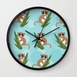 pattern - lemur on green branch on blue background Wall Clock