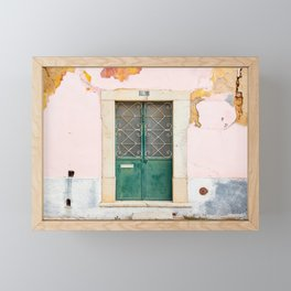 Pink wall with old door in Portugal Framed Mini Art Print