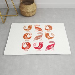Colourful bird collection - pink, orange and copper palette Rug