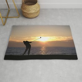 Playing Golf At Sunset Rug