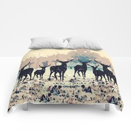 Deer in the snowy forest Comforters