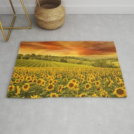 Red sunset over the rolling sunflowers and sunflower fields of Tuscany, Italy Rug