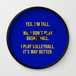Tall people play volleyball Wall Clock