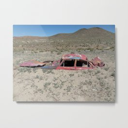 Car in a sea of sand Metal Print