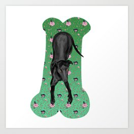 Black Greyhound Puppy on a Green Bone-shaped Carpet Art Print