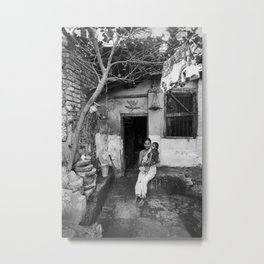 Mother and daughter by the doorway Metal Print
