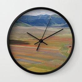 The colorful valley of Castelluccio di Norcia Wall Clock