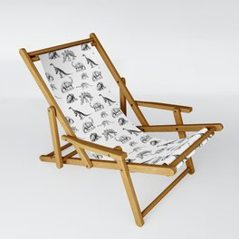 Museum Animals | Dinosaur Skeletons on White Sling Chair