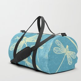 Abstract dragonflies in yellow on textured blue Duffle Bag
