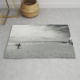 surfer on solana beach, san diego, california Rug