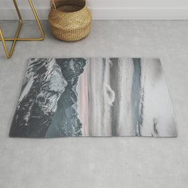 cloudy days with snowy mountains Rug