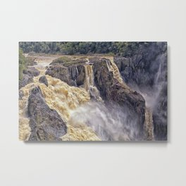 Powerful water going over the falls Metal Print