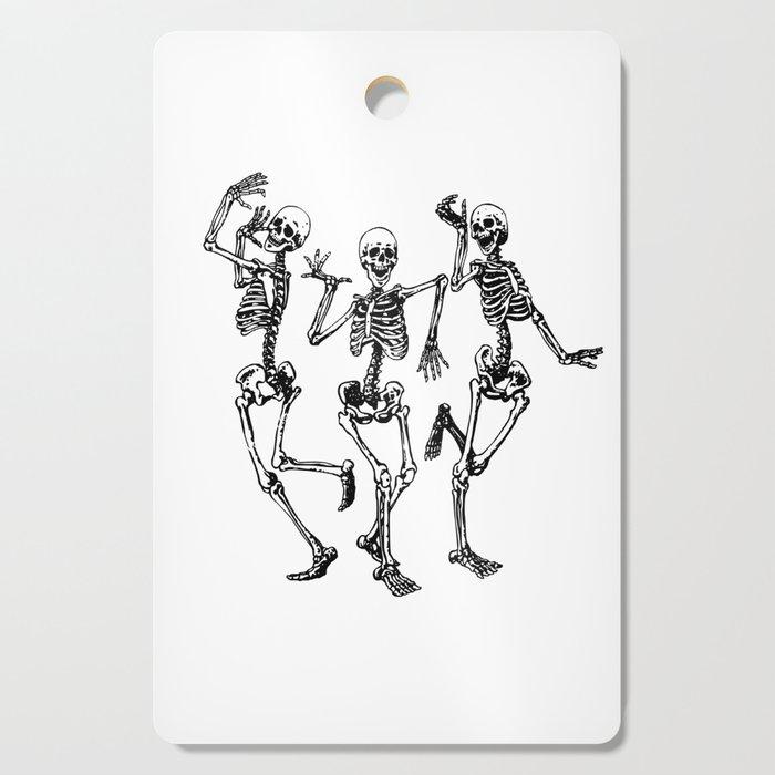 Three Dancing Skulls Cutting Board