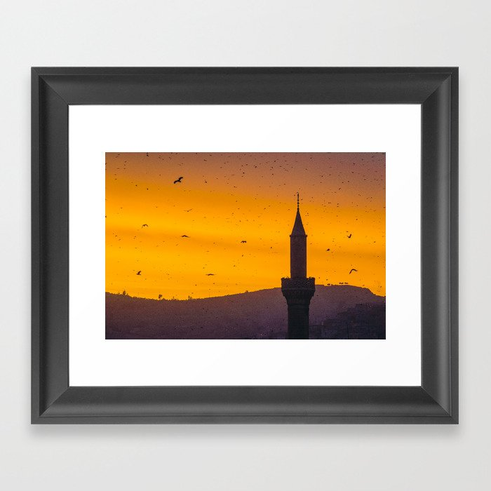 A minaret engulfed by birds 2 Framed Art Print