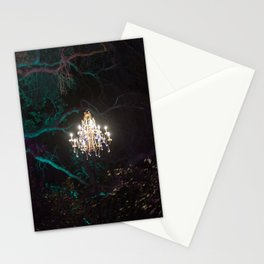 Enchanted forest of light - brightly lit chandelier magically hovering in the middle of the forest Stationery Cards