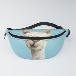 Cute alpaca portrait on blue sky illustration Fanny Pack