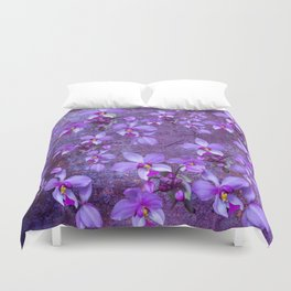purple orchids on a textured wall Duvet Cover