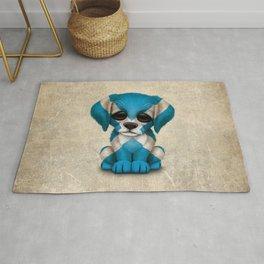 Cute Puppy Dog with flag of Scotland Rug