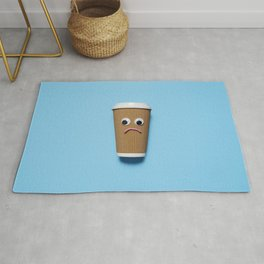 Sad disposable coffee cup on blue Rug