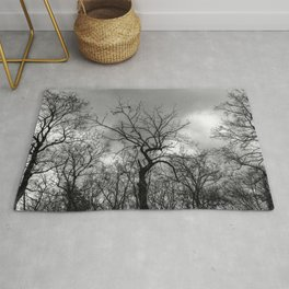 Witchy black and white tree Rug