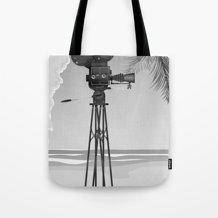 Vintage old time movie camera on a beach Tote Bag