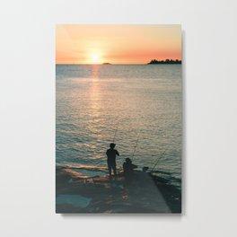 Three fisherman enjoy a beautiful sunset at the shore of 'Colonia del Sacramento, Uruguay'. Metal Print