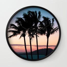 Tropical palm trees swaying in the breeze at sunset on Hamilton Island Wall Clock