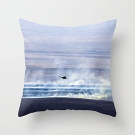 A Russian search and rescue helicopter flies over the burning Kazakh steppe Throw Pillow
