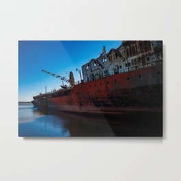 Huge ruins of an abandoned boat on the coast. Metal Print