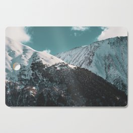 Snowy Mountains Under Teal Sky - Alaska Cutting Board