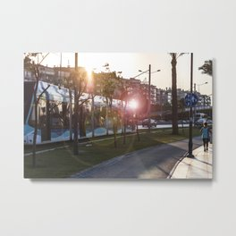Tram running between the street and the walking path in Izmir Metal Print
