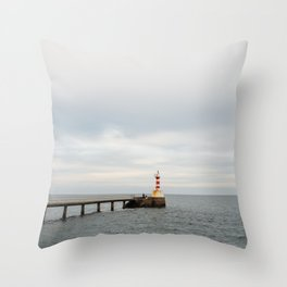 A small northumberland lighthouse stretched our to sea at dusk. Throw Pillow