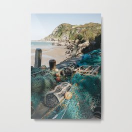 Fishing nets and lobster pots in the harbour at Ilfracombe. Devon, UK. Metal Print