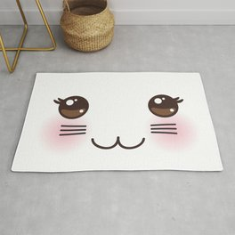 Kawaii funny cat muzzle with pink cheeks and big black eyes on white background Rug