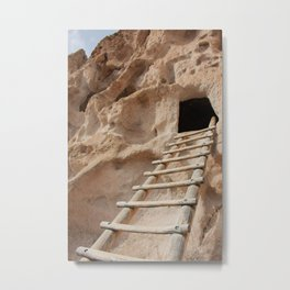 Close-up of ladder leading up to ancient cliff dwelling entrance at Bandelier National Monument in New Mexico desert Metal Print